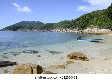 Beautiful sand beach of D Lagoon with boat in Perhentian islands, Malaysia