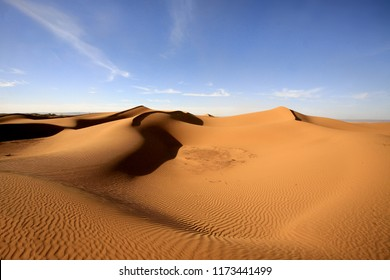 beautiful sand dunes of the Morrocan desert and blue sky, Morocco, Africa