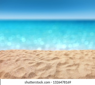 beautiful sandy beach with blur ocean background summer concept