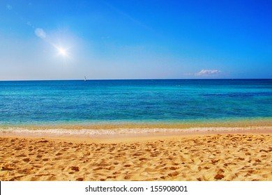 Beautiful sandy beach with bright colors and lens flare effect