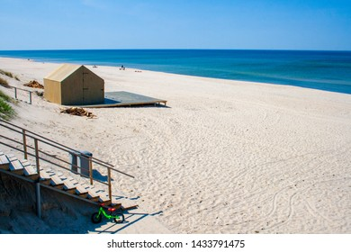 Beautiful sandy beach with dunes in Nida - Curonian Spit and Baltic Sea, Nida, Klaipeda, Lithuania, Unesco heritage with wooden house on the shore