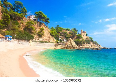 Beautiful sandy beach in Lloret de Mar, Spain, Costa Brava. Turquoise water in spanish resort on sunny day