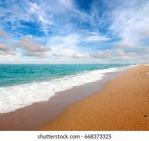 Beautiful sandy beach of the Mediterranean coast sea under the sunny sky