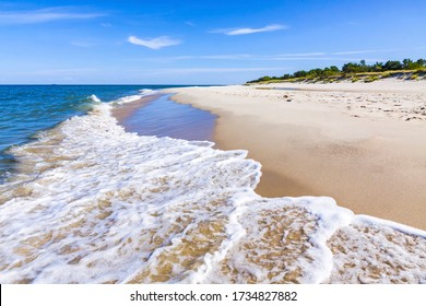 Beautiful sandy beach on Hel Peninsula, Baltic sea, Pomeranian Voivodeship, Poland. Hel is a 35-km-long sand bar peninsula in northern Poland separating the Bay of Puck from the open Baltic Sea