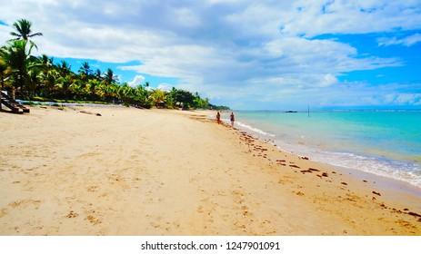 Beautiful, sandy beach with palm trees and turquoise sea in Arraial d'Ajuda, near Porto Seguro, Bahia, Brazil