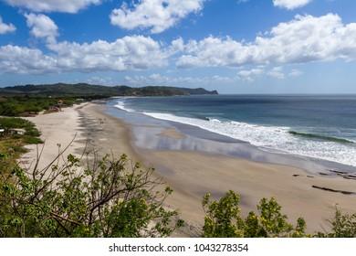 Beautiful sandy beach in Tola, Nicaragua. Santana Beach with blue waters and great waves