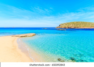 Beautiful sandy Cala Comte beach with azure blue sea water, Ibiza island, Spain