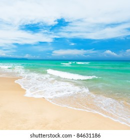 Beautiful sandy tropical beach at sunny day