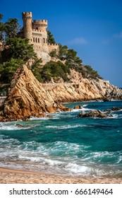Beautiful Sant Joan Castle on the rocky coast of Costa Brava in Spain