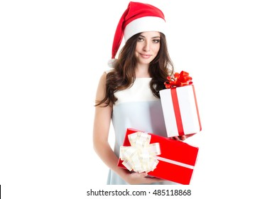 Beautiful Santa Girl Isolated white background. Smiling woman posing in studio with gifts.