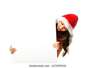 Beautiful santa woman holding white empty banner