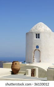 Beautiful Santorini landscape with white tower on blue sky background