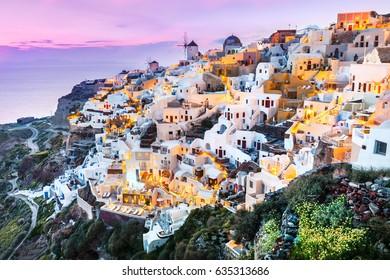 Beautiful Santorini sunset scenery, traditional white architecture, Santorini island, Oia village, Greece, Europe. Santorini is famous and popular summer vacation romantic resort.