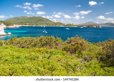 Beautiful Sardinian bay with several anchorage yachts