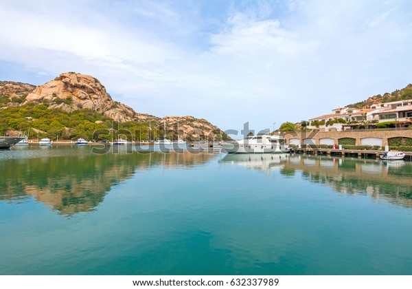 Beautiful Sardinian port Poltu Quatu and mountains. Poltu Quatu, Sardinia, Italy