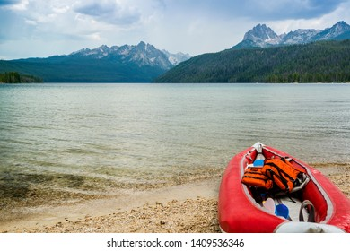 Beautiful Sawtooth mountain range as seen from Redfish Lake in Stanley, Idaho, USA with a boat in the forground