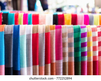 Beautiful scarf textiles in thailand. Colorful hand woven fabric in Thai local market. Sale on walking street in countryside of Thailand. - Selective focus.