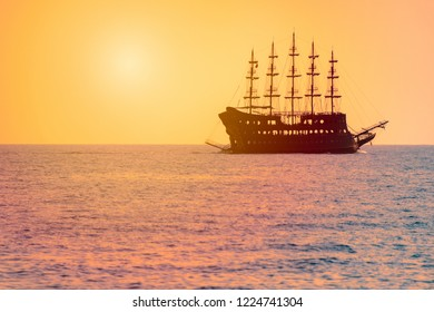 Beautiful scene with cruise sailboat sailing in sea at sunset at horizon