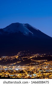 Beautiful scene at dusk where we can see the Chimborazo volcano and the city of Ambato at the end of the blue hour.