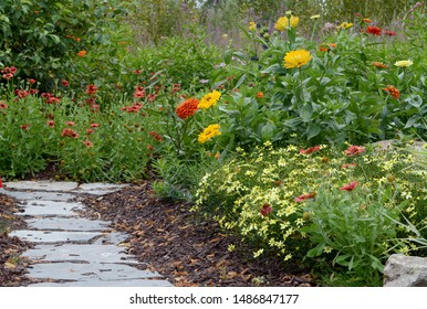 A beautiful scene focused on a flower garden built to attract butterflies and preserve their livlihood.