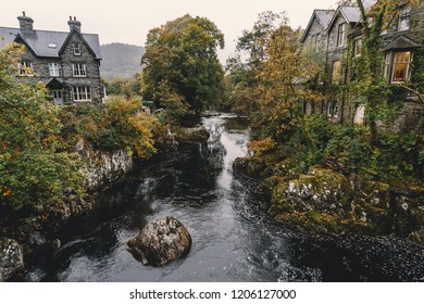 Beautiful scene of houses with mountain creek waterfalls autumn landscape of Betws y Coed, Wales