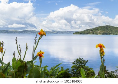 beautiful scene with a relaxing lake view and a tropical rainforest surrounding lake Arenal in Costa Rica