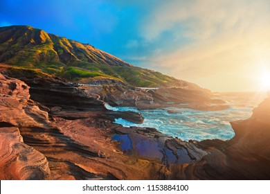 Beautiful scene with rocky beach and morning ocean with sunrise, cocohead viewpoint in Oahu island in Hawaii
