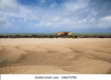 Beautiful scene of a shipwrecked boat on a beach in Brazil