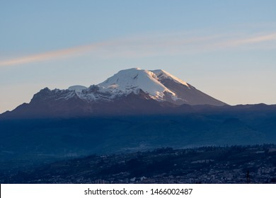 Beautiful scene at sunset where we can see the Chimborazo volcano next to the Carihuairazo, shot made from the city of Ambato