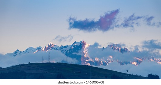 """Beautiful scene at sunset where we can see the volcano """"El Altar"""", taken from the city of Ambato"""