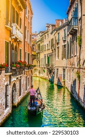 Beautiful scene with traditional gondola and canal in Venice, Italy