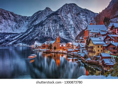 Beautiful scene with Winter evening fairytale town Hallstadt near the lake.
