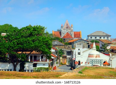 Beautiful scenery of ancient Dutch Galle Fort (UNESCO World Heritage Site) with Christian church and Buddhist stupa - view from fortification wall, southwest coast of Sri Lanka island, South Asia