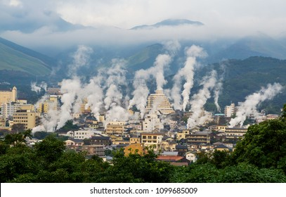 Beautiful scenery of Beppu cityscape with Steam drifted from public baths and ryokan onsen. Beppu is one of the most famous hot spring resorts in Japan, Oita, Kyushu, Japan