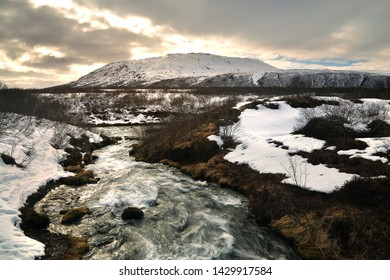 Beautiful scenery of Bruarfoss waterfall during the sunsets at southern Iceland. Bruarfoss is the famous natural landmark and tourist destination place of Iceland. Travel and natural Concept.
