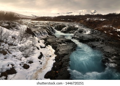 Beautiful scenery of Bruarfoss waterfall at southern Iceland where a series of small runlets of water runs into a beautiful, turquoise-blue colored pool. Travel and natural Concept.
