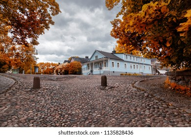 Beautiful scenery, cobbles and wooden houses on the island of Suomenlinna, a journey through the islands of Finland
