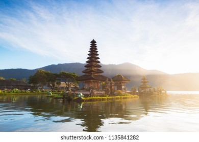 Beautiful scenery at dawn in Indonesia, famous place on the island of Bali, a temple on the lake.