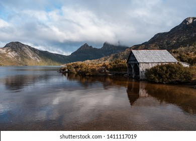 Beautiful scenery of Dove Lake with boatshed and Cradle Mountain in the composition during evening at Cradle Mountain - Lake St Clair National Park, Tasmania, Australia.