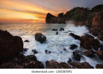 Beautiful scenery during sunrise of AO Bo thonglang Beach at Bang Saphan District ,Prachuap Khiri Khan province in Thailand. Travel and natural Concept