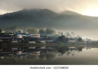 Beautiful scenery during sunrise with the mist and water reflection of the Chinese village at the Lee wine ruk thai lake, Mae Hong Son in Thailand is a very popular for photographers and tourists