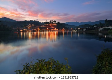 Beautiful scenery during twilight of Yunnan Chinese Village is located on the hill at Ban Rak Thai , Mae Hong Son in Thailand.This is very popular for photographers and tourists.