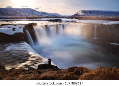 Beautiful scenery of Godafoss waterfall at sunset in Iceland. Godafoss waterfall is famous natural landmark and very popular for photographers and tourists. Attractions and travel concept