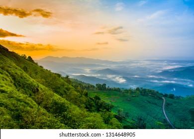 Beautiful Scenery of God's own Country Kerala, colorful Mountain Sunrise with Cloudy sky amazing nature kannur palakkayam thattu