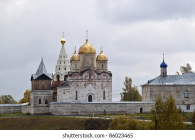 Beautiful scenery. Golden domes of the church against the background of the cloudy autumn sky.