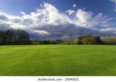 Beautiful scenery with green meadow and dramatic sky