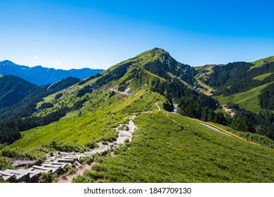 Beautiful Scenery of the green mountain and blue sky at Hehuanshan Main Peak, Taroko National Park, Wuling, Nantou County, Taiwan