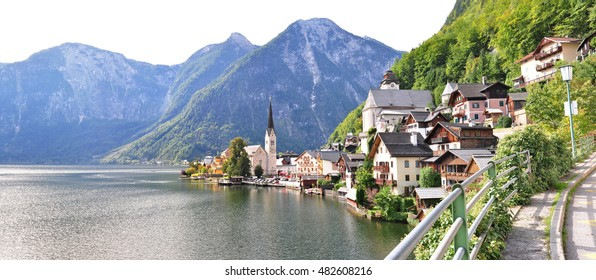 Beautiful scenery of Hallstatt, Austria, with the Gothic Catholic church iconic, clear lake, and high moutian.