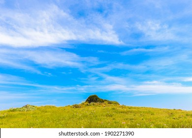 A beautiful scenery of a hill on a meadow under the blue skyin Menorca, Spain