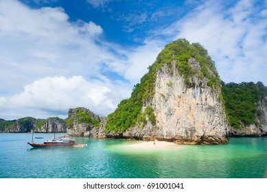 Beautiful scenery with an island and a wild beach in the archipelago Cat Ba, North Vietnam.
